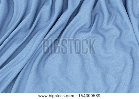 Blue fabric folds. Smooth abstract cloth decoration background. 3d render