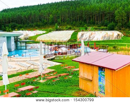 Egerszalok Hungary - September 27 2015: People resting in hot water pools of the Saliris resort. The Egerszalok spa pools contain water rich in calcium magnesium and hydrocarbonate minerals.
