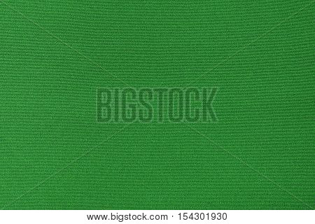 Green knitwear fabric texture background. Close up