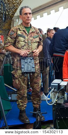 TRIESTE ITALY - OCTOBER 10: Official of Italian army using a weapon remote control on October 10 2014