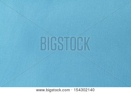 Cyan linen fabric texture background. close up