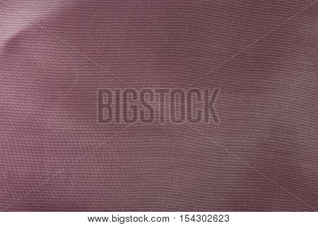 Red wrinkled  fabric texture background. Close up