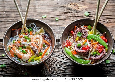 Two Dishes With Vegetables, Noodles And Seafood