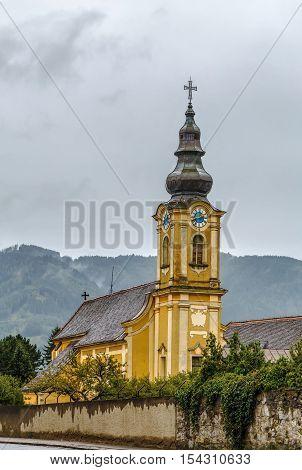 Yellow baroque church in Friesach Carinthia Austria