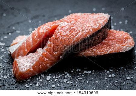 Fresh Raw Salmon On A Black Rock