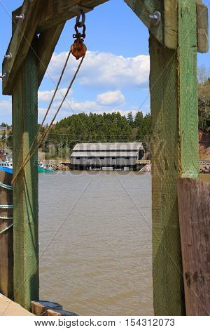 covered Bridge in St. Martins New Brunswick during High Tide on the Bay of Fundy Canada