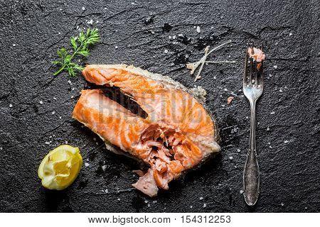 Enjoy your fresh fried salmon on black rock
