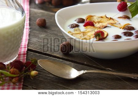 cereals breakfast apple, cereal, granola, breakfast, lunch, milk, apple, raspberry, fruit, berry, spoon, chocolate, balls, American, food, diet