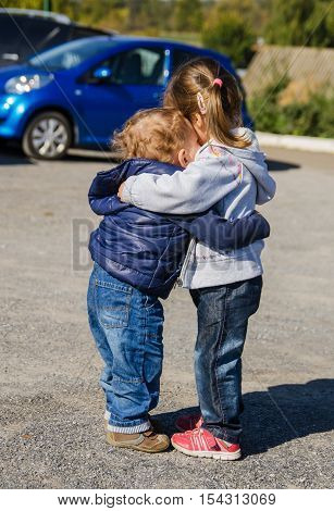 Strong arms of the boy and the girl, after a long separation