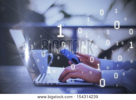 Side view of male hands using smartphone and laptop with binary code. Technology concept