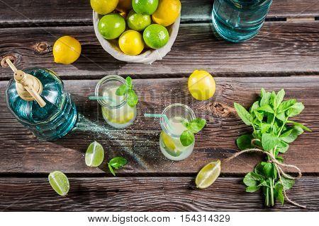 Lemonade made of fresh fruits on wooden table