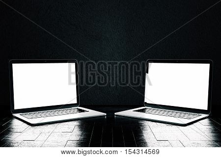 Close up of two blank white laptop with blank screens placed on patterned shiny dark surface. Mock up 3D Rendering