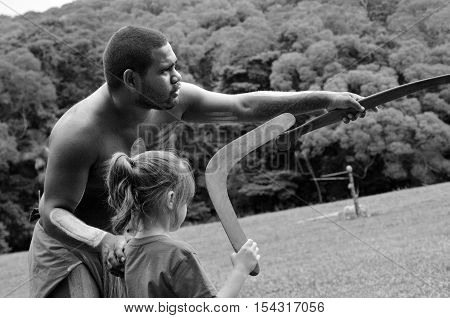 Yirrganydji Aboriginal Warrior Teaches A Little Girl How To Throw A Boomerang
