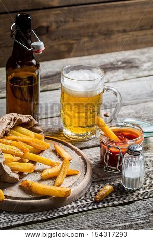 Fresh French Fries With Ketchup And Beer