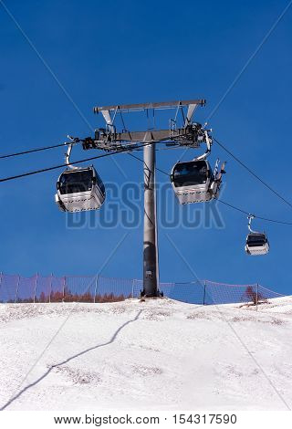 Gondola cable car with a pole in Alps, Tirol, Austria