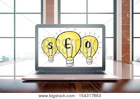 Laptop with drawn seo lamps on screen placed on wooden desktop. Window with city view in the background. Search engine optimization concept. 3D Rendering
