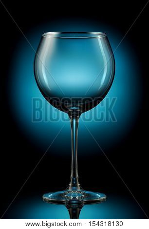 Empty wine glass on a color background.