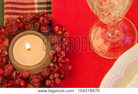 Burning candle on festive table. Christmas theme. Top view. Horizontal.