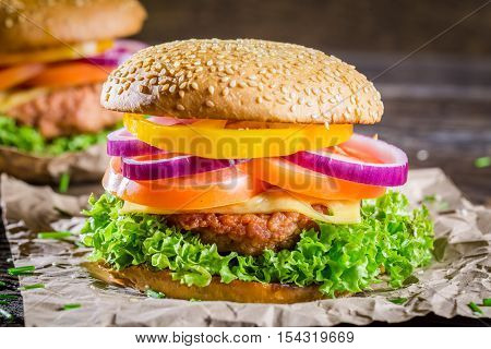 Closeup of tasty homemade hamburger on wooden table