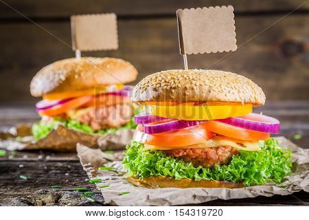 Two tasty homemade burgers on wooden table