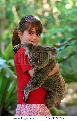 Little Girl Holding A Koala