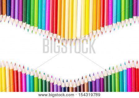 Color pencils rainbow vawe arrangement with white copy space