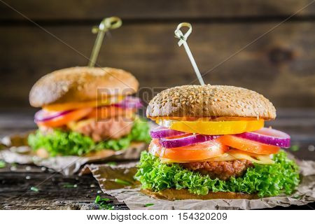 Burger made ​​from vegetables and beef on wooden table