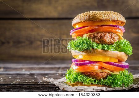 Big fresh and tasty homemade hamburger on wooden table