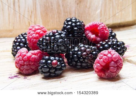 Black Red Berries On A Wooden Background.