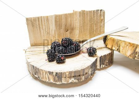 Blackberry In A Spoon And Wooden Background.