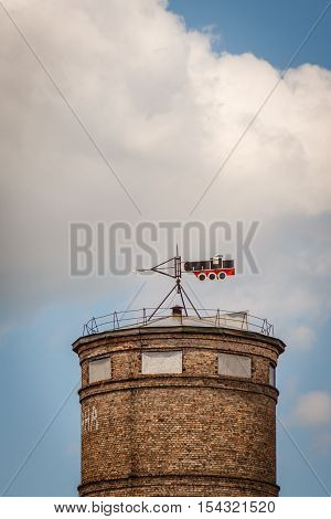 vane on the water tower in the shape of a steam locomotive