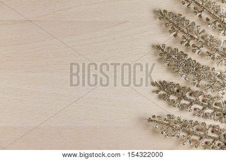 golden fern on a wooden background. shine