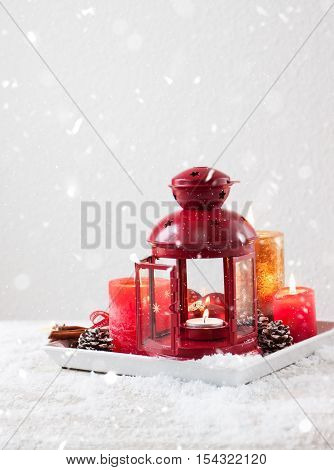 Christmas lantern with candles snow christmas decorations and fir cones copy space