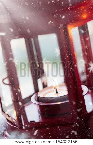 Christmas lantern with candle snow christmas decorations closeup