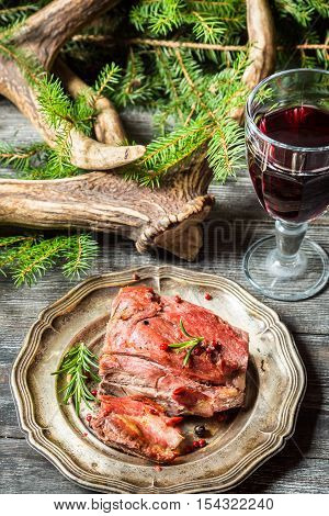 Piece Of Venison Served With Red Wine