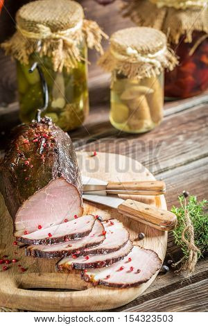 Tasting Fresh Piece Of Ham In A Smokehouse