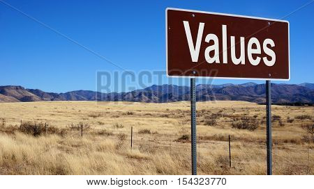 Values road sign with blue sky and wilderness