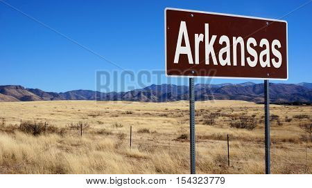 Arkansas road sign with blue sky and wilderness