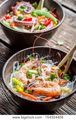 Chinese mix vegetables with seafood on wooden table
