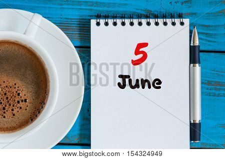 June 5th. Image of june 5 , calendar on blue background with morning coffee cup. Summer day, Top view.