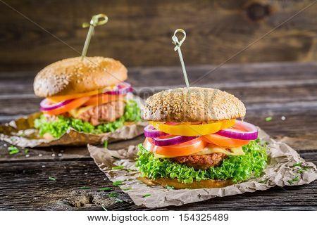 Closeup of tasty homemade hamburger on wooden table