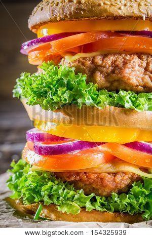 Closeup of double-decker homemade hamburger on wooden table