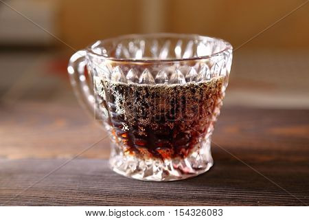 glass with kvass on a wooden table.
