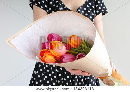 Woman Holds Warped Tulip Flowers Bouquet