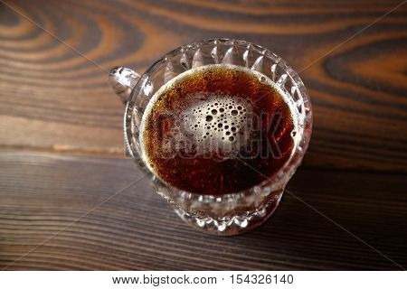 glass with kvass on a wooden table. Top view