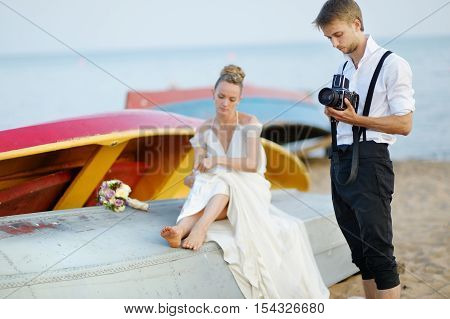 Groom Taking A Photo Of His Bride