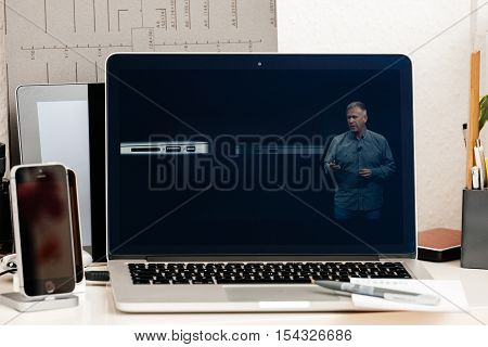 PARIS FRANCE - OCT 28 2016: Apple Computers website on new MacBook Pro Retina with OLED Touch bar in geek creative room showcasing Apple Keynote presentation of Thunderbolt 3 with USB 3