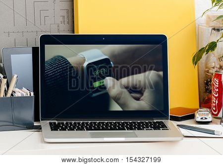 PARIS FRANCE - OCT 28 2016: Apple Computers website on new MacBook Pro Retina with OLED Touch bar in geek creative room showcasing Apple Keynote presentation of accesibility presentation movie
