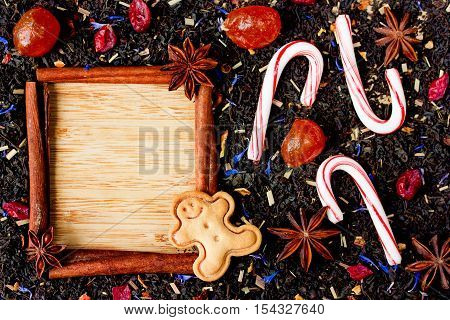 Christmas tea and sweets background blank space for text in cinnamon frame