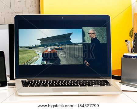 PARIS FRANCE - OCT 28 2016: Apple Computers website on new MacBook Pro Retina with OLED Touch bar in geek creative room showcasing Apple Keynote - 'Minecraft Pocket Edition' Coming to Apple TV